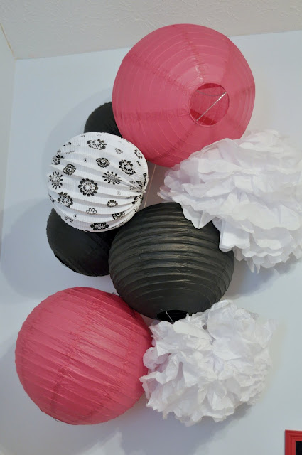 party decorations, pink and black, paper lanterns, paper pom poms