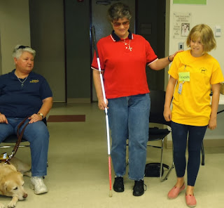Laurel teaches sighted guide to day campers