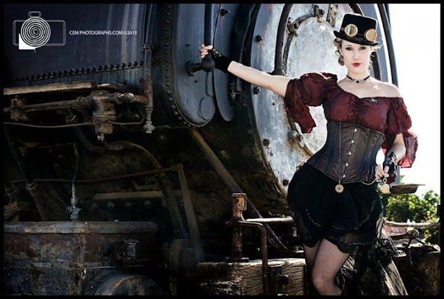 Steampunk cosplayers posing on steam train