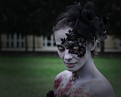 This zombie woman is wearing a lace masquerade half mask over one eye, these strapless adhesive lace masks and tattoos are reusable. They make a sexy mask for masquerade balls, boudoir photos, burlesque dancers, etc.