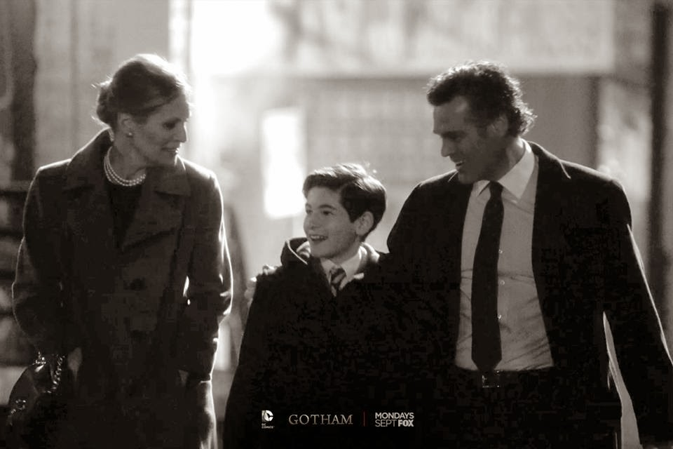 David Mazouz as a young Bruce Wayne with Grayson McCouch and Brette Taylor as his parents Dr Thomas Wayne and Martha Wayne in Fox Gotham TV Show Pilot Episode