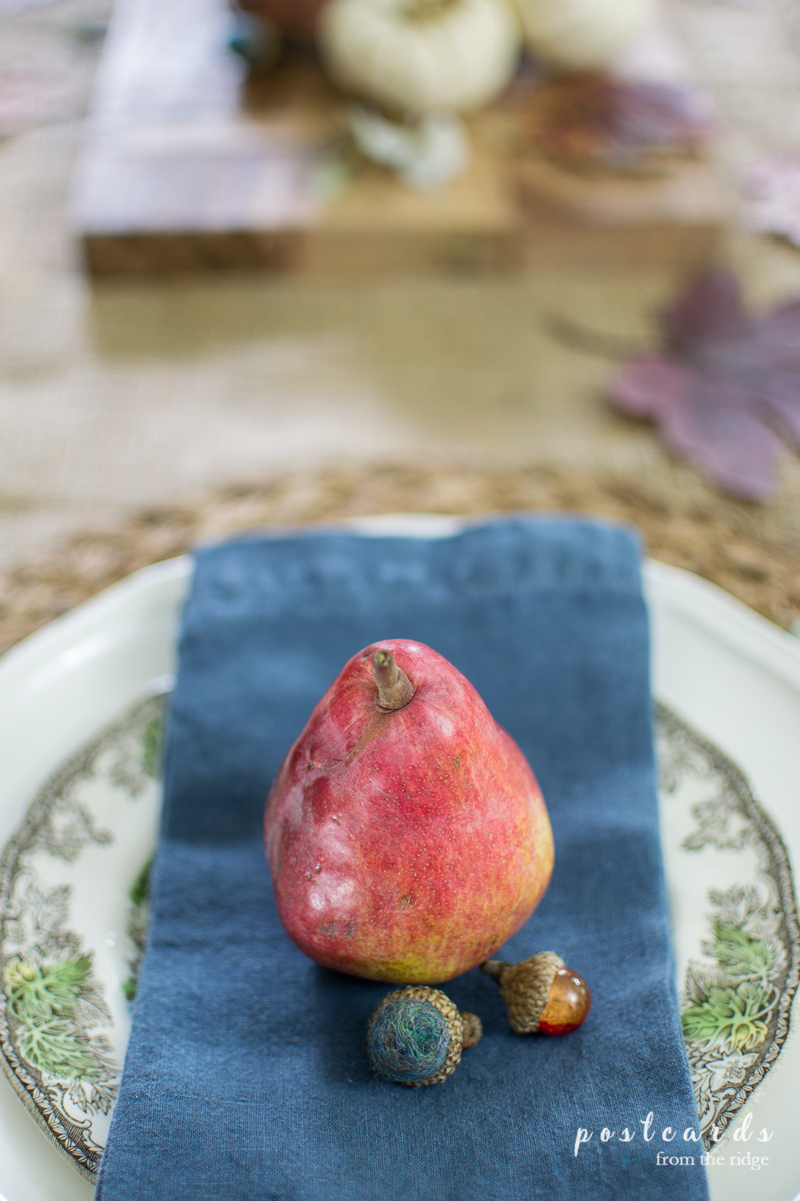 red pear on blue napkin