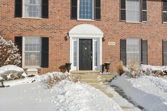 brick colonial house shutters snow Home Alone movie