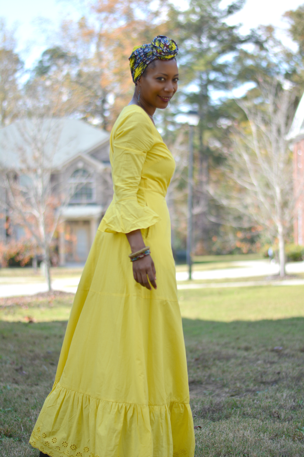 vibrant yellow maxi dress worn in fall