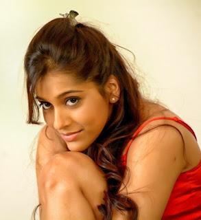 Rashmi Gautam Spicy Pics in Red Transparent Saree from movie Antham