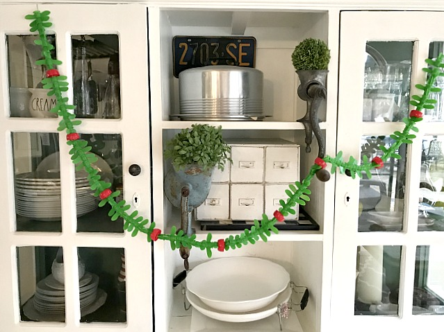 Plastic recycled applesauce top garland for Christmas
