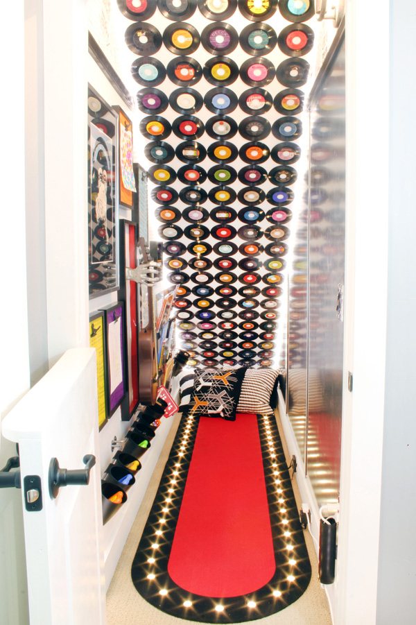 UNDER STAIRS PLAYROOM. The disfunctional storage space under the basement stairs was transformed into a rock & roll themed kids playroom under the stairs. This music themed play space includes a music gallery wall, a wall covered in vinyl records, DIY sheet music wallpaper, and a magnetic ping pong ball wall maze.