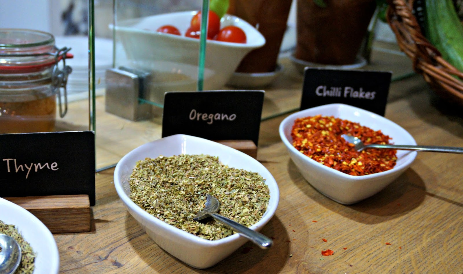 Selection of herbs in bowls