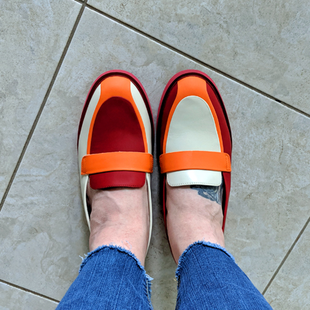 image of my feet wearing dark pink, orange, and white loafers
