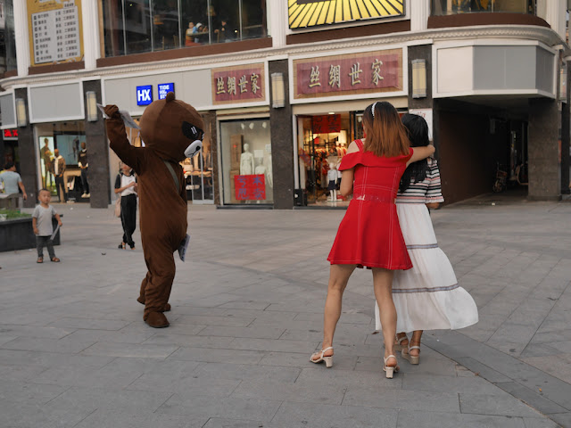 person in bear suit handing out flyers