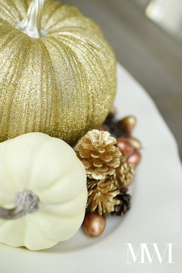 Gold glitter pumpkins paired with creamy white neutral decor for a fall tablescape centerpiece. | #falldecor #falldecorations #falldecorating #monicawantsit