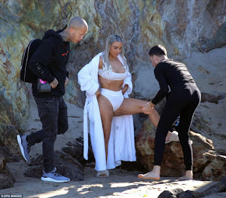Kim Kardashian bares her famous butt in beach shoot