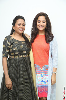 Actress Suma in Black Salwar Suit and Anusuya in orange Dress at winner movie press meet part 1 February 2017 (49).JPG