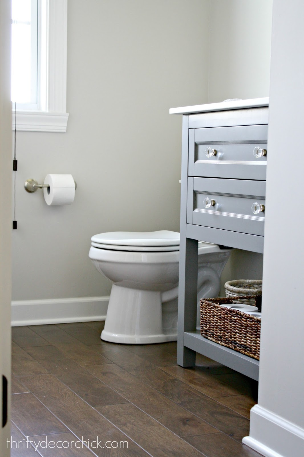 Dark wood floors, gray vanity bathroom