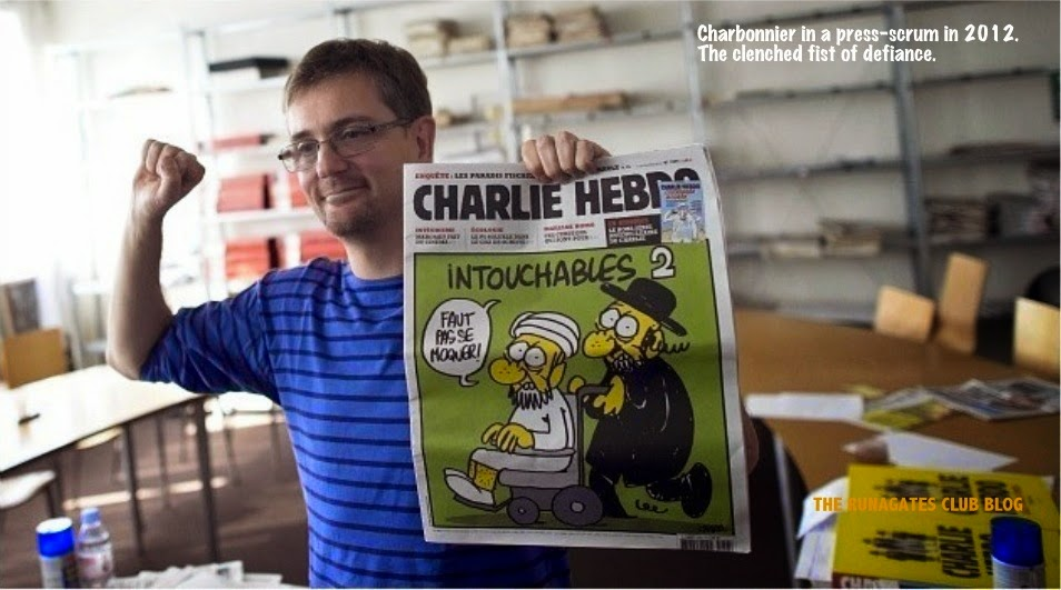 Stephane Charbonnier, editor of CHARLIE HEBDO - clenched fist in 2012