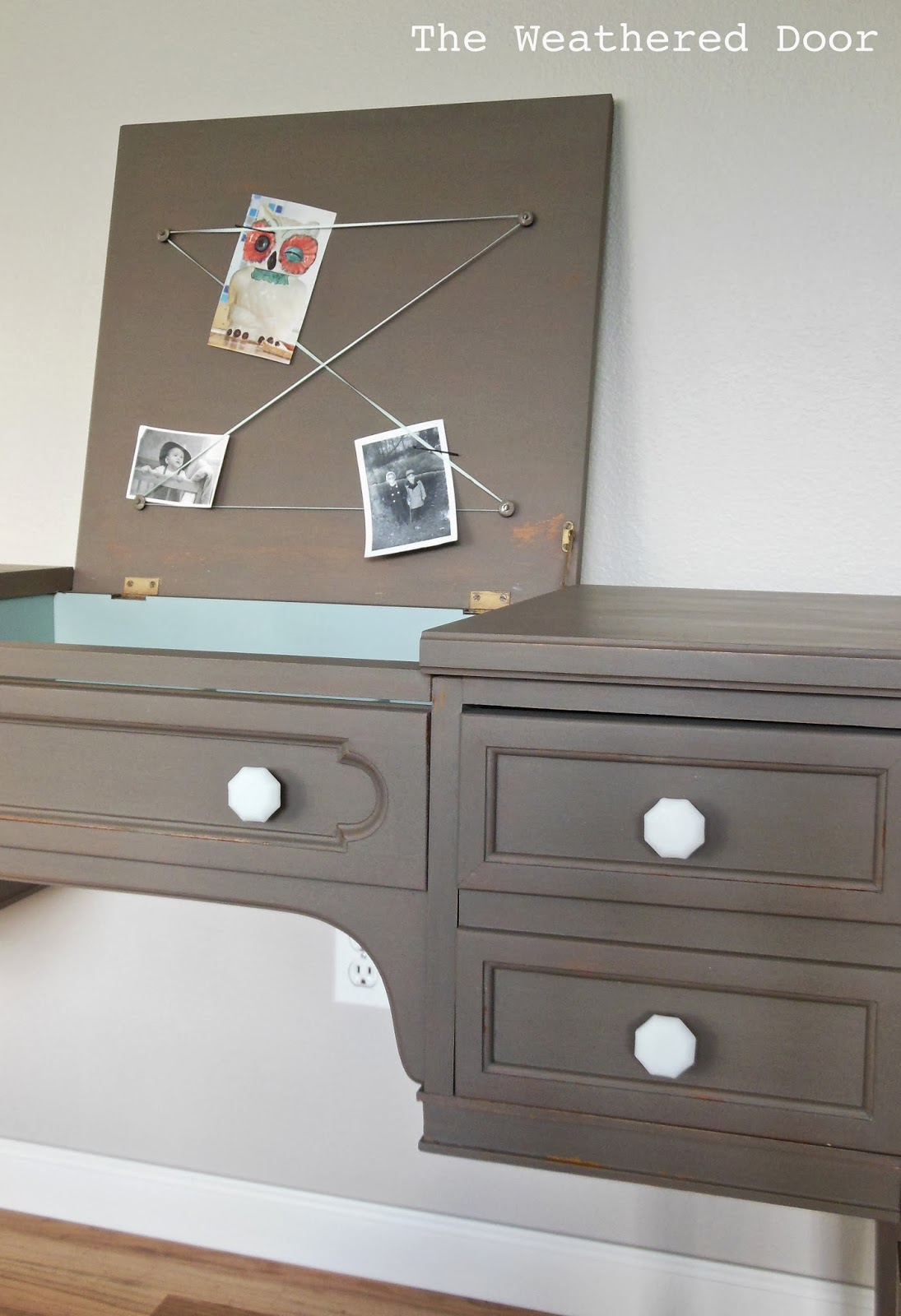 A taupe writing desk with milk glass knobs  The Weathered Door