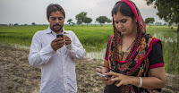 Farmers receive updates on climate smart practices on their phones, as part of an adaptation project in Karnal, India. (Credit: CCAFS/Prashanth Vishwanathan) Click to Enlarge.