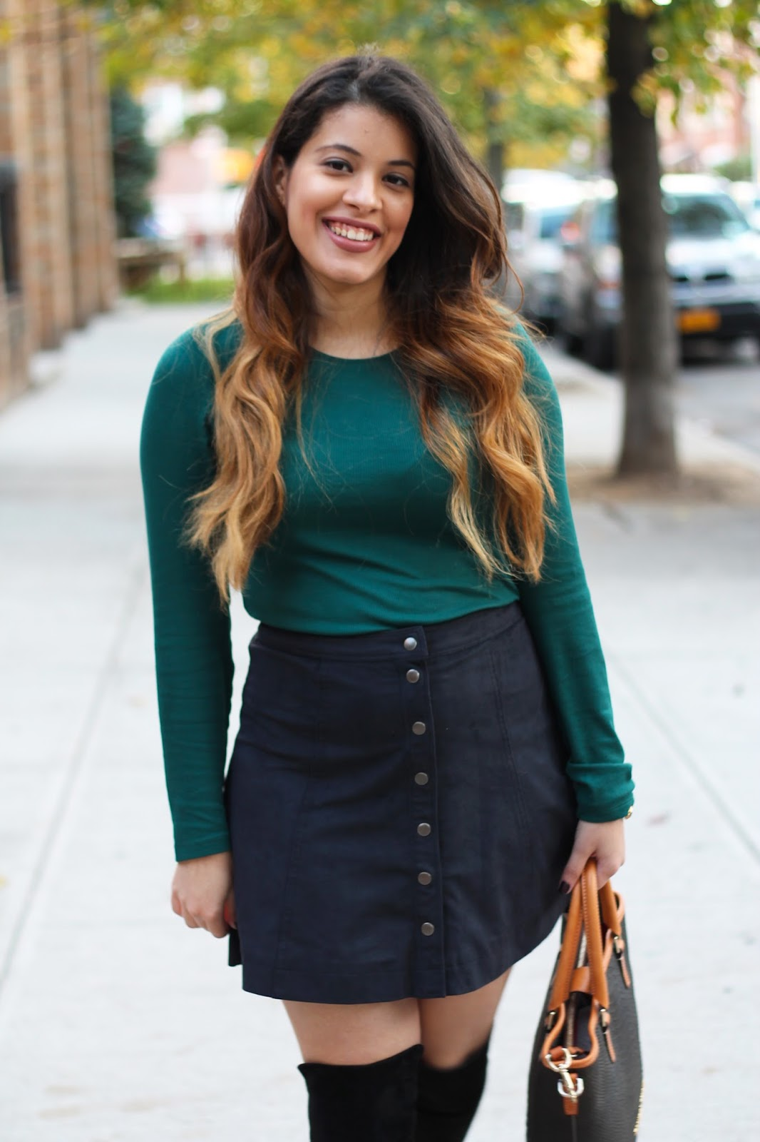NYP Turns Two; Green Long-Sleeve Top and a Black Button Skirt with Over-The Knee Boots.
