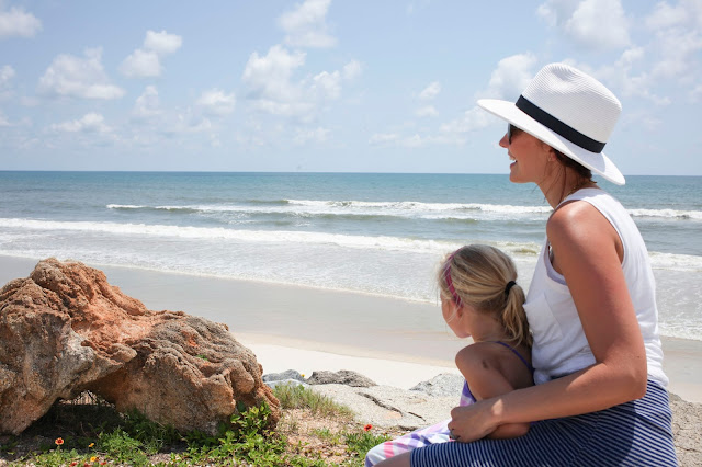 Amy West and daughter looking at ocean