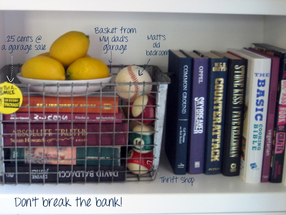 Styling a bookshelf doesn't have to be expensive. It can be super fun to use garage sale favorites to add some charm!