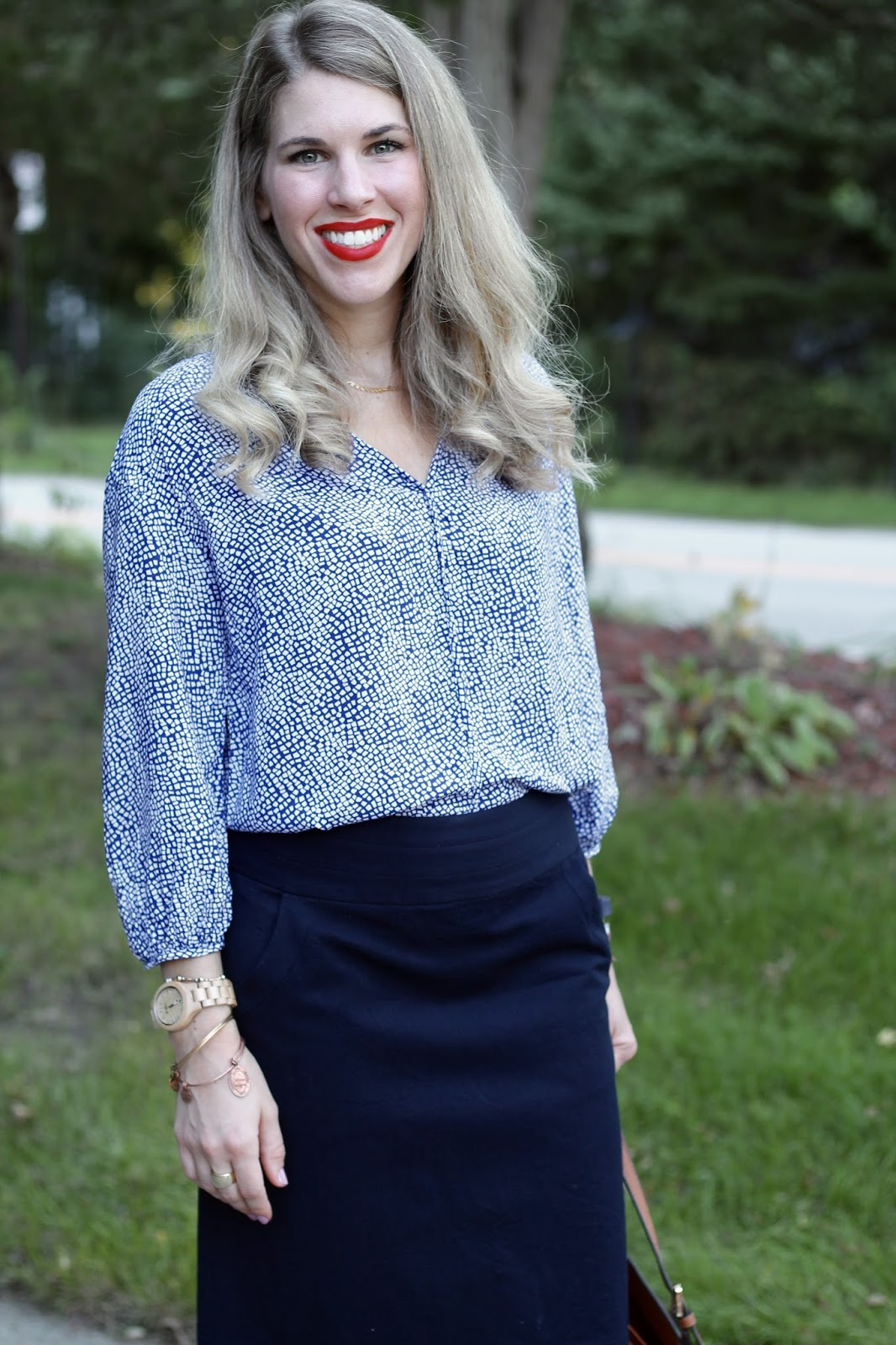 printed blue blouse, navy pencil skirt, Tory Burch tote, pink Tory Burch flats, wood watch