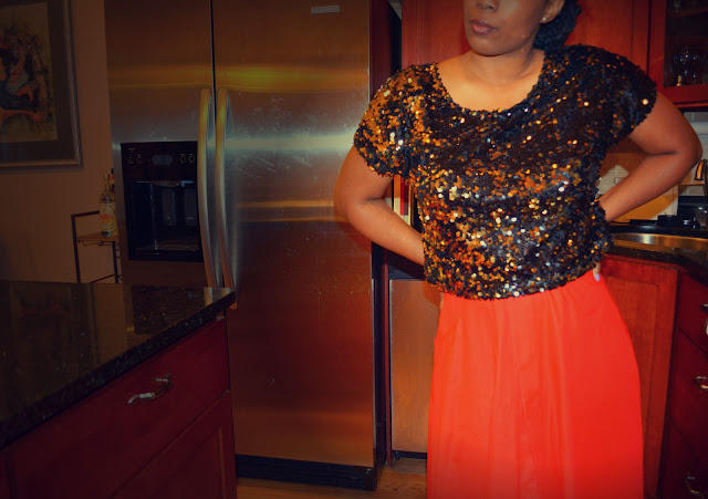 sequin crop top worn with a maxi skirt