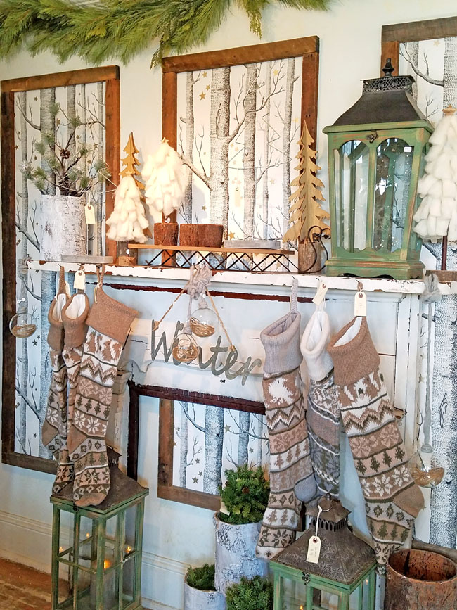 wooden tones for this Christmas mantel with stockings and birch tree wall displays