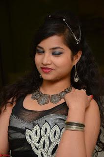 Shrisha Dasari in Sleeveless Short Black Dress At Follow Follow U Audio Launch 069.JPG