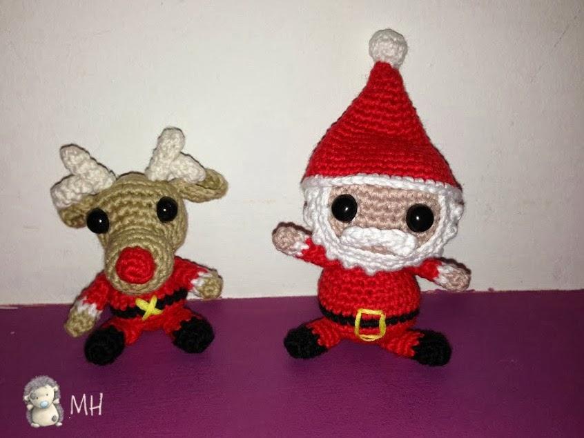 Pequeños Papá Noel y reno