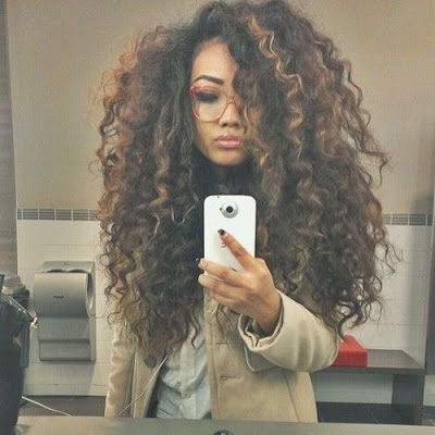 Naturally thick and curly hair with highlights
