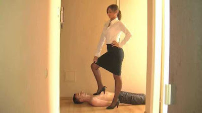 femdom bdsm, dominant woman in black and white placing her foot on a man's chest
