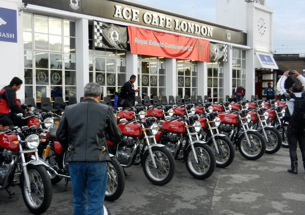 Line up of red motorcycles in front of the Ace Cafe.