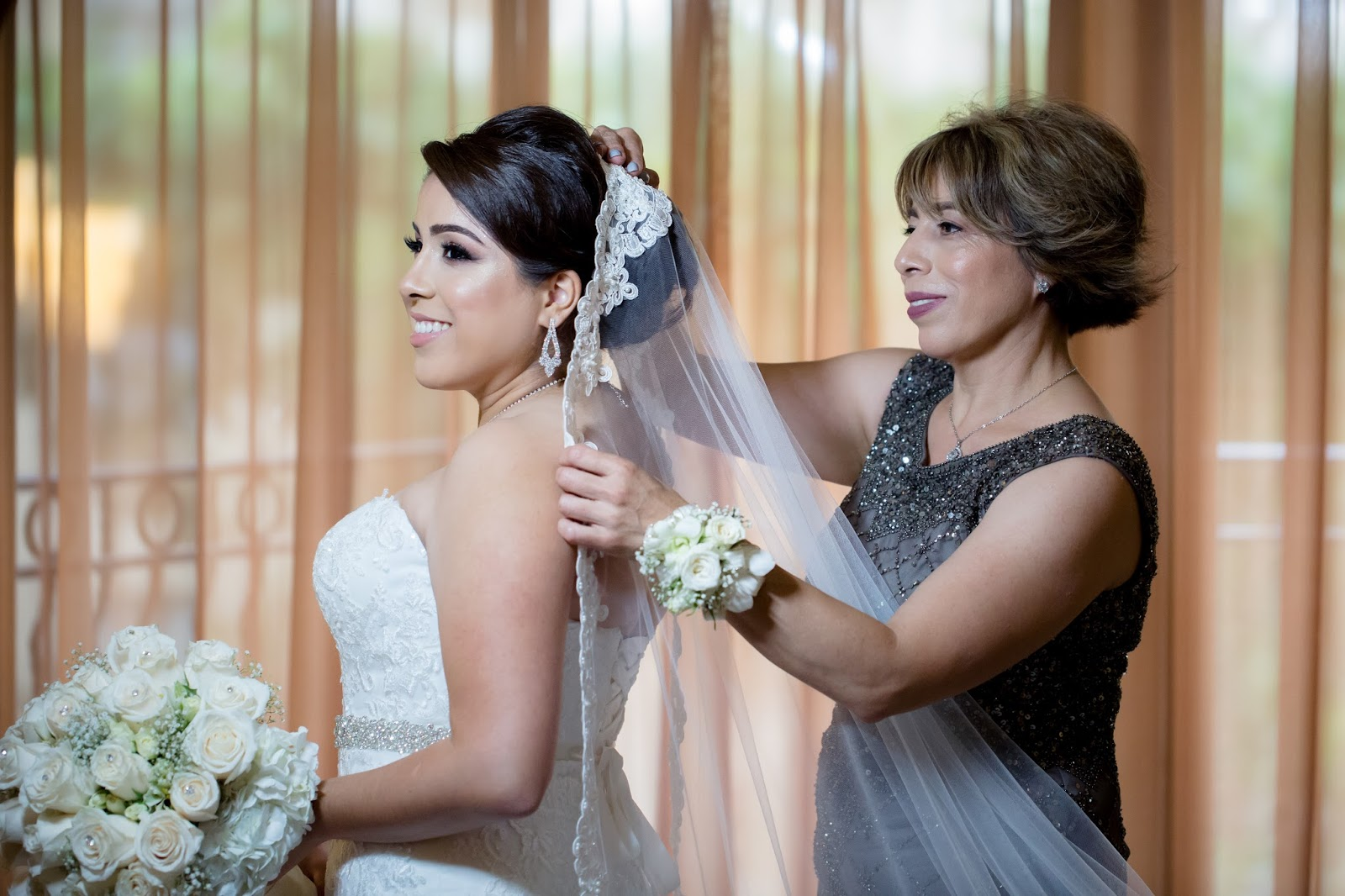 Mother of the Bride Helps Bride With Veil