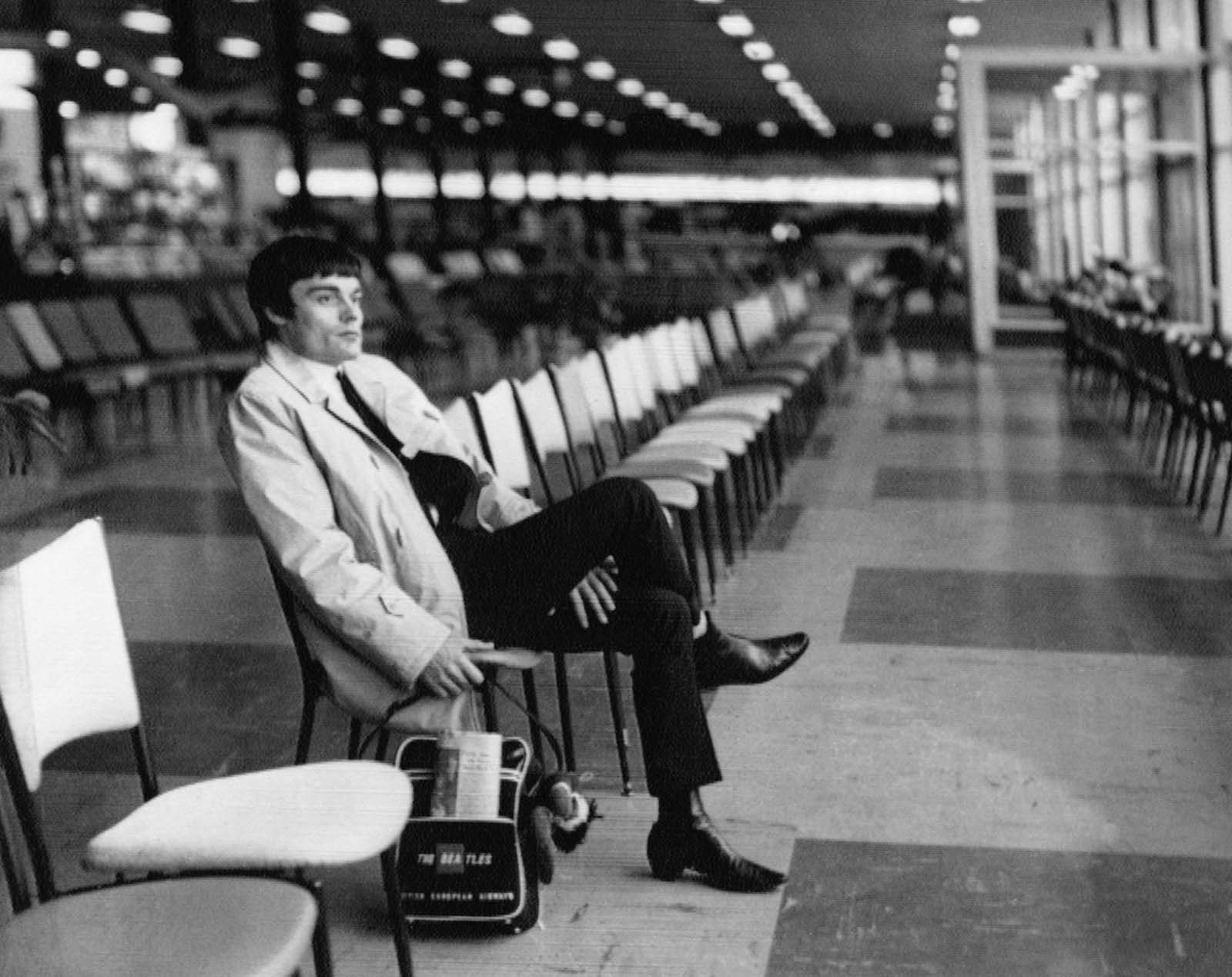 Drummer Jimmy Nicol, who had been stand-in for tonsillitis-stricken Beatle Ringo Starr, sits alone and contemplative at Melbourne's Essendon Airport, while waiting to return home on June 15, 1964. Ringo rejoined the Beatles the day before.