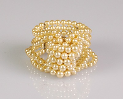 Pearl bracelet twisted in knot named Napoleonic Knot Bracelet by Jacques Fath