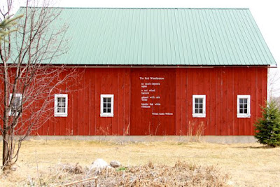 does the red barn hold a red wheelbarrow?