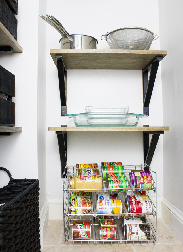 Pantry organization tip: Put the can rack on the floor to free up shelf space!