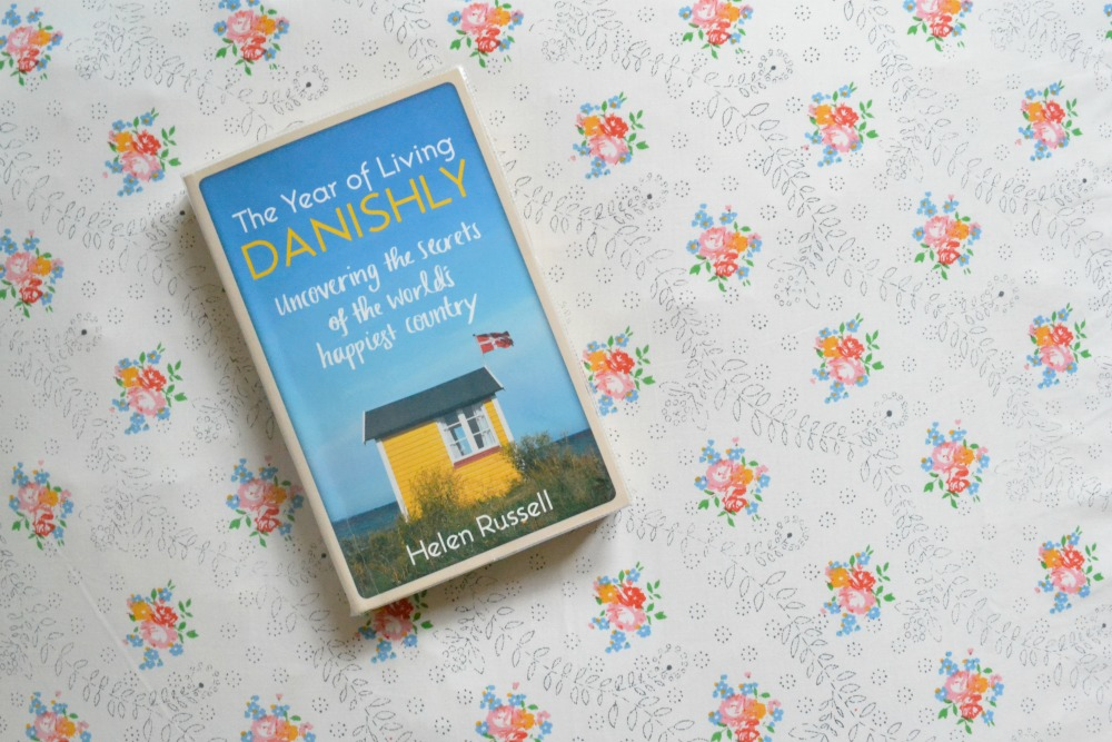the year of living danishly denmark book paperback library helen russell floral cushion vintage