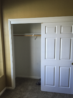 Before photo of office closet with carpet and old paint
