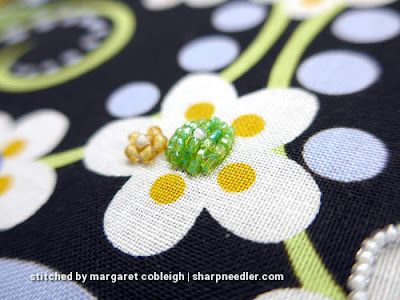 Beaded raised flower centre. (Wild Child Japanese Bead Embroidery by Mary Alice Sinton)