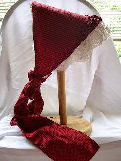 Red and black fanchon bonnet, 1865 style.