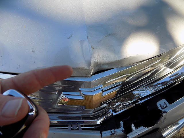 Dented hood & cracked grill on 2017 Chevy Volt before collision repairs at Almost Everything Auto Body.