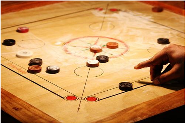 Carrom board playing surface