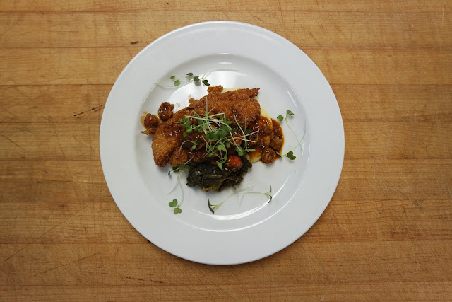 Crawfish Etoufée smothered Fried Catfish with Stone-Ground Grits and Mustard Greens