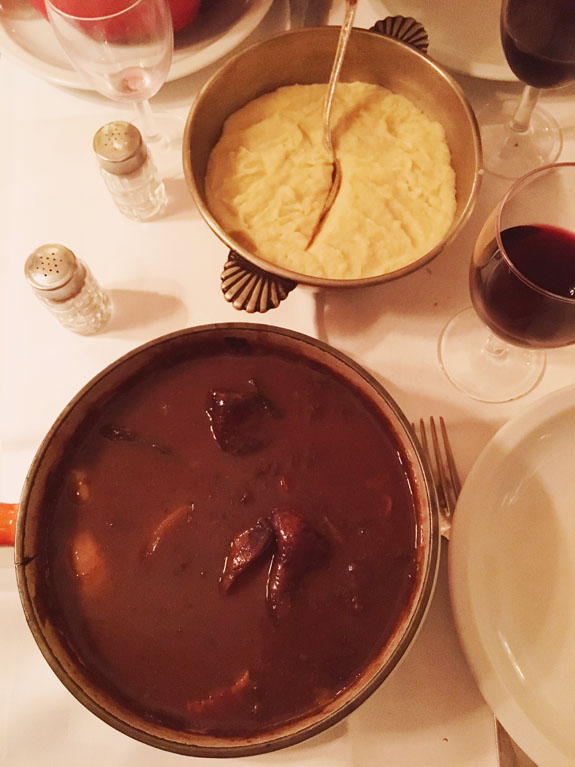 where to eat in paris coq au vin from a la biche au bois