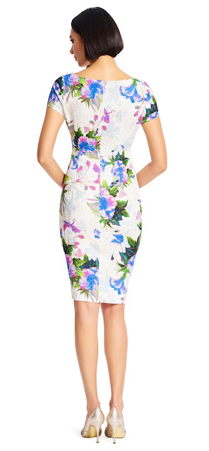 Bright blooms adorn this v-neck floral sheath dress, featuring a v-neck bodice and cap sleeves