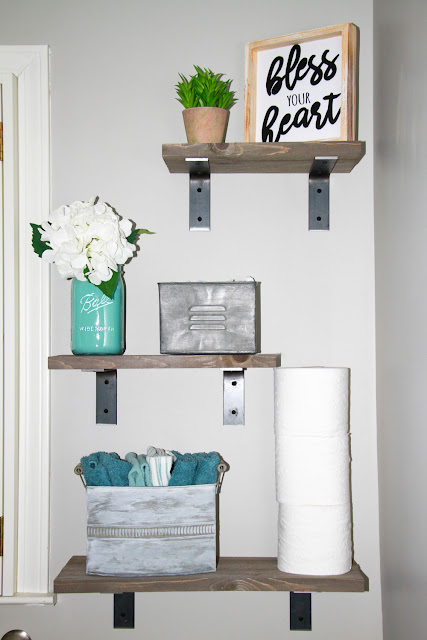 DIY Rustic Barnwood Shelves / Midwestern Mama.  Don't have access to old barn wood, no problem!  Grab some at Home Depot and make some of these custom shelves!