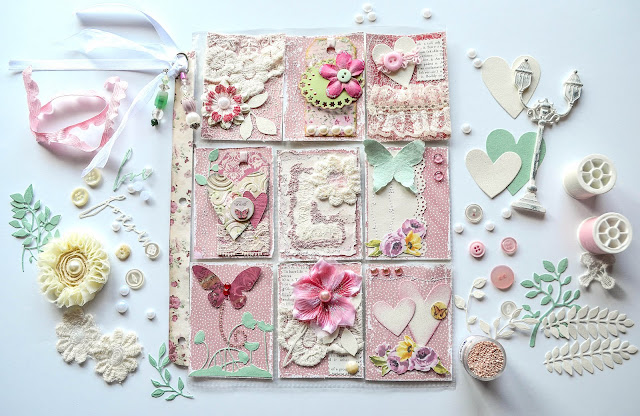 Shabby chic pocket letter in romantic valentine style in pink and pale green and ivory, with sparkly ribbon and die cuts, flowers, lace, and prills