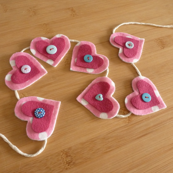 Pink felt hearts with button middles on a garland