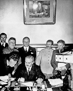 Molotov signing Pact_standingbehindare Ribbentrop and Stalin